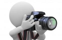 9881156-photographe-a-genoux-avec-son-appareil-photo-slr